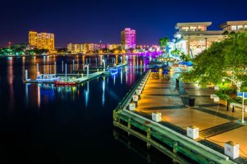 View of the Riverwalk at night in Tampa, Florida.